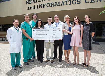 Members of the UNM Center for Surgical Critical Care along with donors Nancy Hansen and her daughters, Sarah and Elise, contribute to the Critical Care Students Organization (CCSO). Left to right: Dr. Isaac Tawil, Dr. Jonathan Marinaro, Dr. Todd Dettmer, three student leaders in the CCSO (Kimberly Kreitinger, Steven Salcido and Eric Quintana), Nancy Hansen, Elise Hansen and Sarah Hansen. Photo: Paul Akmajian