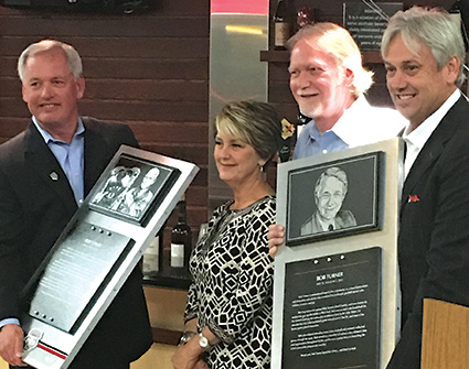 Left to right, UNM VP for Athletics Paul Krebs, Sharon Davidson, Larry Turner and UNM Men's Basketball Coach Craig Neal gather during the dedication of the Bob Turner Letterman's Lounge and Bob Turner Board Room at WisePies Arena last October. Photo: Courtesy UNM Athletics