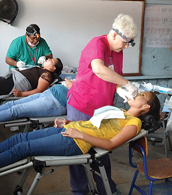 Dr. Shelly Fritz and Dr. Carlos Tuil provide dentistry to patients in a Guatemalan school earlier this year. Dr. Fritz recently created an estate gift to support UNM's special-needs dentistry program.