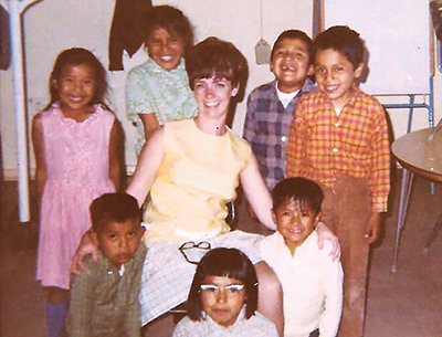 Kay Glanz (then Martin) is surrounded by several of her first-grade students in Round Rock, Ariz., during the 1968-1969 school year.